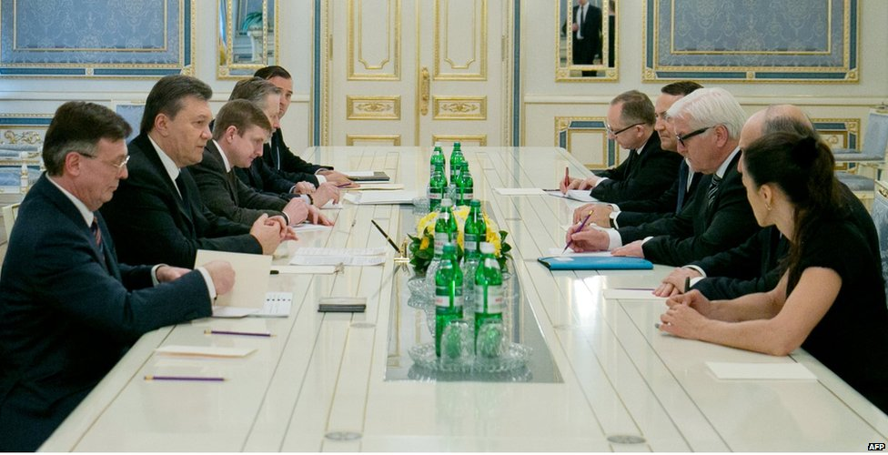 President Yanukovych (centre left) meets European foreign ministers (right) in late-night talks in Kiev