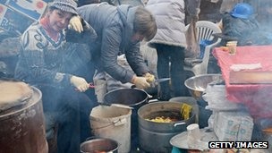 Women preparing meals in Independence Square