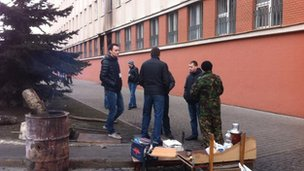 Group keeps watch at security service building, taken by protesters on Tuesday. We weren't allowed in #Lviv