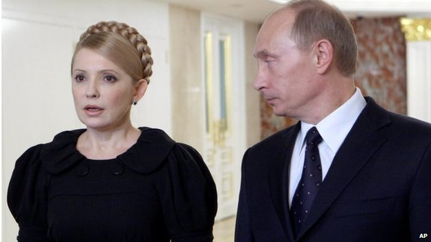 Sunday, Jan. 18, 2009 file photo Vladimir Putin, right, looks at his Ukrainian leader Yulia Tymoshenko