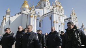 A group of police officers from western Ukraine arrive on St Michael's Cathedral to show their support for the opposition in Kiev, Ukraine, on 21 February 2014.