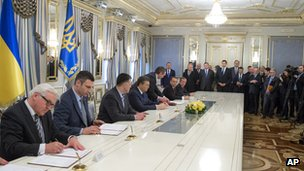 Ukrainian opposition leaders and President Yanukovych, alongside the German and Polish foreign ministers, sign the deal in Kiev on 21 February
