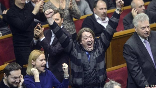 Ukraine's opposition members react during a Parliament session in Kiev