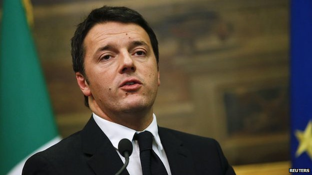 Italian Prime Minister Matteo Renzi talks to reporters at the end of talks  with party leaders at the parliament in Rome