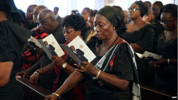People attend the funeral of BBC presenter Komla Dumor on February 21, 2014, in Accra,