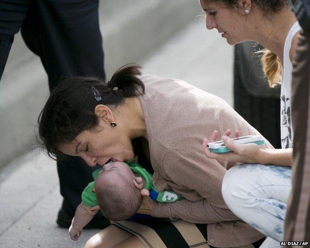 Pamela Rauseo, 37, performs CPR on her nephew, five-month-old Sebastian de la Cruz 20 February 2014