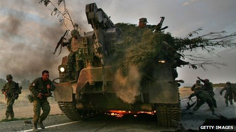 Georgian soldiers escape burning armoured vehicle on the road to Tbilisi on 11/08/2008