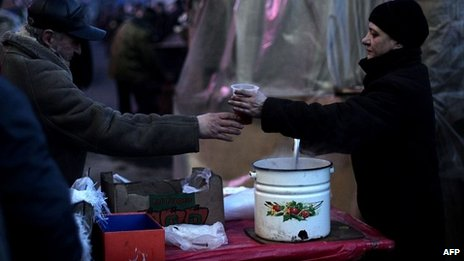 Anti-government protester gets food from comrade in Independence Square in Kiev on 05/02/2014