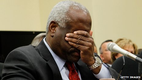 Clarence Thomas rubs his eyes during a congressional budget hearing in April 2010.