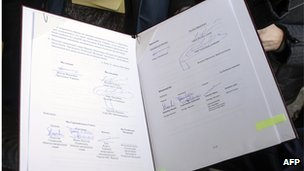 Folder contains Kiev deal signed by President Yanukovych and opposition leaders on 21 February 2014