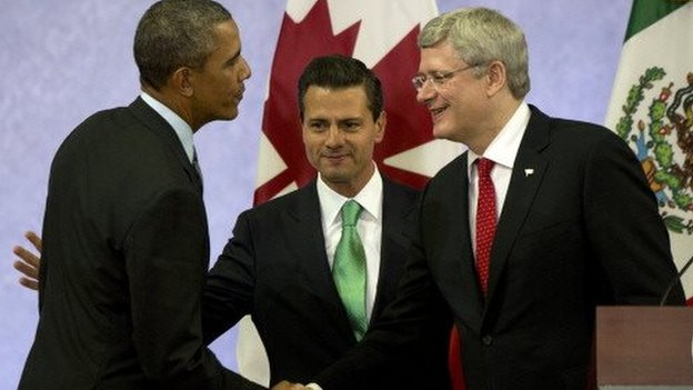 US President  Barack Obama, Mexican President Enrique Pena Nieto and Canadian Prime Minister Stephen Harper at a summit in Mexico on 21 February, 2014