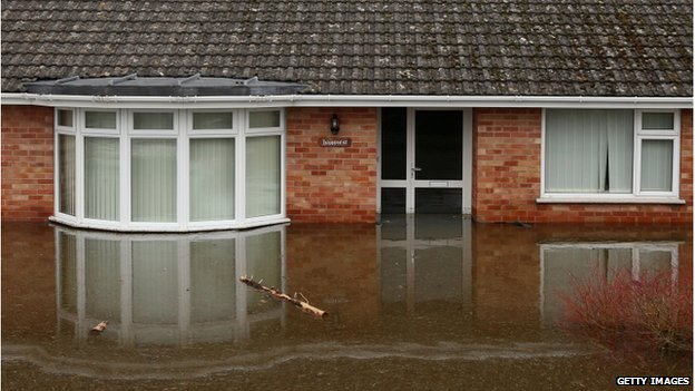 Flood water continues to surround properties in the largely evacuated village of Moorland