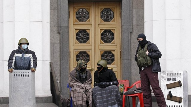 Anti-government protesters guarding the doors to the presidential offices