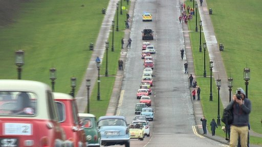 The cavalcade leaves Stormont, heading for the city hall
