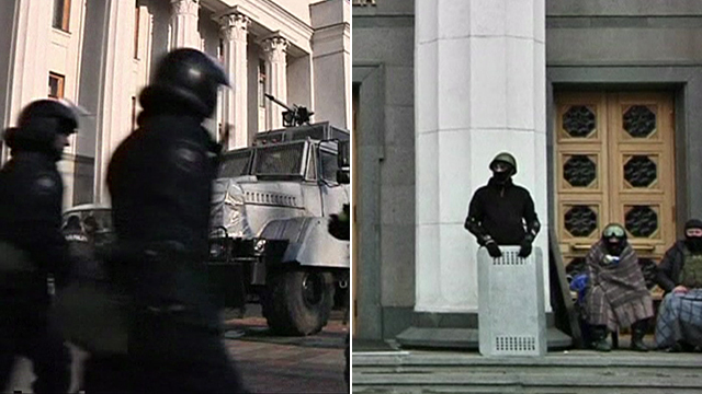 Riot police outside parliament on Friday and 'self defence' guards outside on Saturday