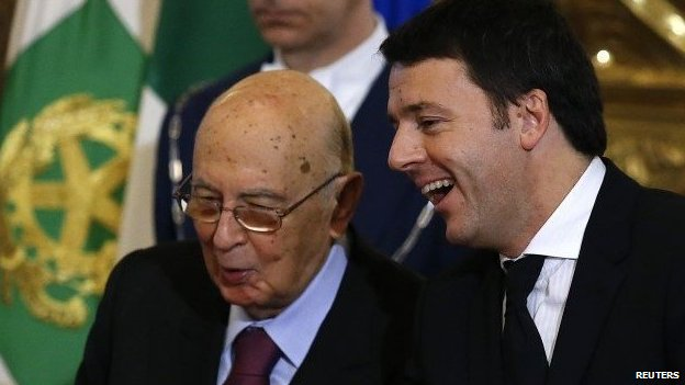 Newly appointed Italian Prime Minister Matteo Renzi (R) talks with Italian President Giorgio Napolitano during the swearing in ceremony for 16 new ministers at Quirinale palace in Rome February 22, 2014