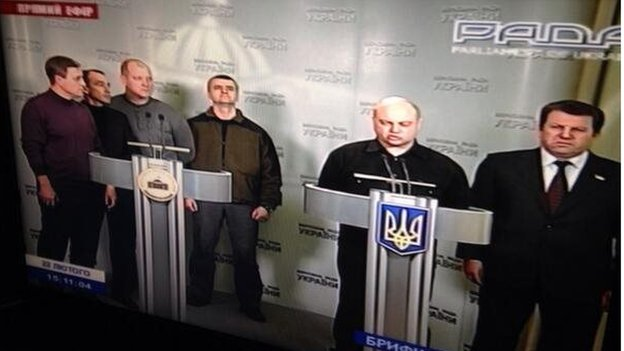 Parliament TV showing the heads of the Berkut riot police, addressing the public