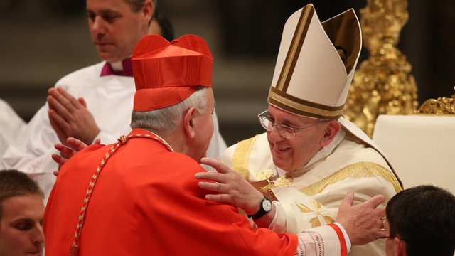 New Cardinal, Archbishop Vincent Nichols receives a hug from Pope Francis