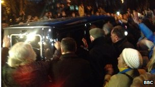 The BBC's Yuri Maloveryan watched ecstatic crowds greet Ms Tymoshenko as she was driven from prison.