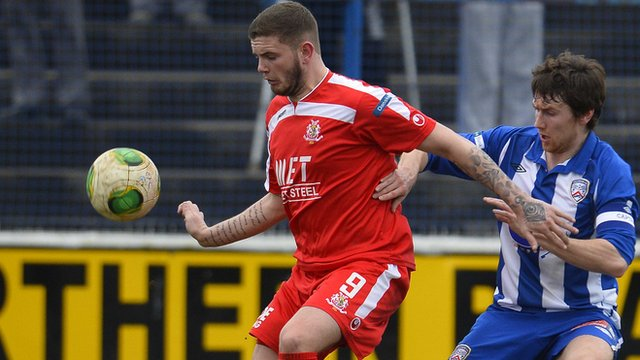 Portadown's Darren Murray in action against Coleraine's Howard Beverland