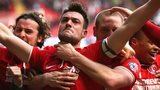 Charlton captain Johnnie Jackson (second left) celebrates his winner against QPR