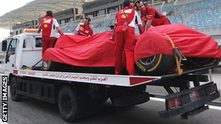 Kimi Raikkonen's car is towed away