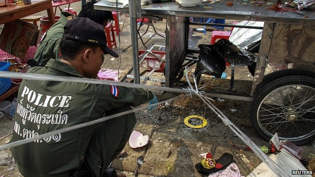 Police scour area of gun and bomb attack in Khao Saming