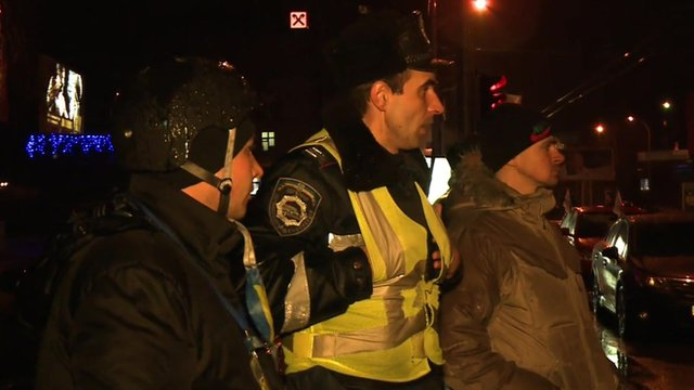 Members of a vigilante group assist traffic police in Kiev
