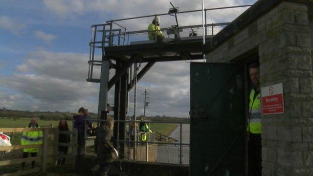Workers raising the Monksleaze sluice gate near Langport