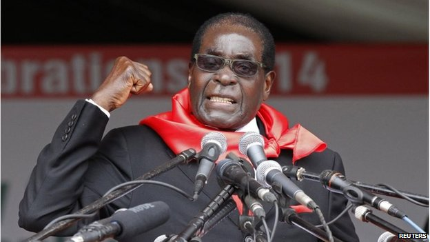 Zimbabwe's President Robert Mugabe addresses supporters during celebrations to mark his 90th birthday
