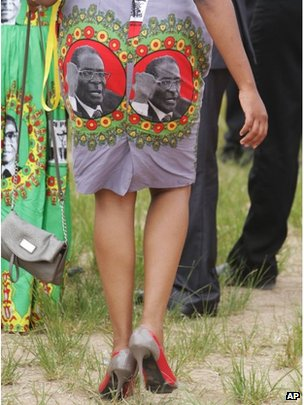 A supporter of Zimbabwean President Robert Mugabe wears a dress with his portrait on the rear