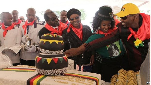 Mr Mugabe and family cut his birthday cake