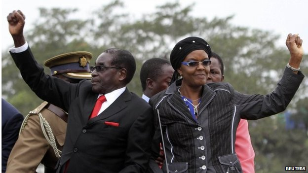 Mr Mugabe moved around the venue in the back of a truck, with his wife Grace