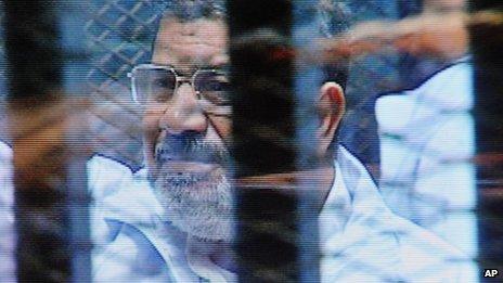 Mohammed Morsi in court. 16 Feb 2014
