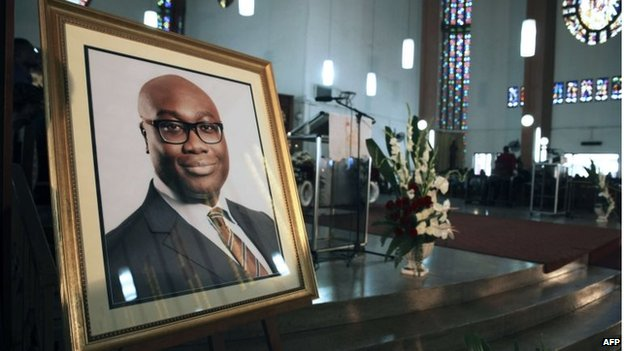 A portrait of BBC presenter Komla Dumor is set during his funeral on Friday