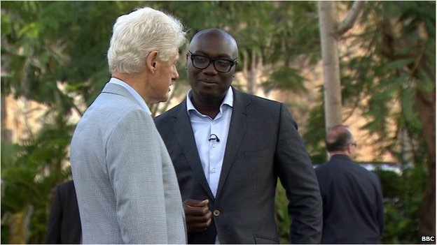 Komla Dumor with former US President Bill Clinton