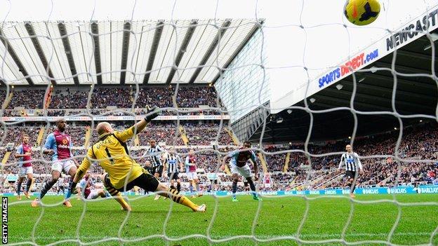 Newcastle striker Loic Remy shoots past keeper Brad Guzan for his side's winner against Aston Villa
