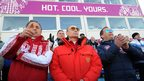 Russia's President Vladimir Putin , Prime Minister Dmitry Medvedev and Sports Minister Vitaly Mutko (L) watch the men's cross-country 4 x 10 km relay event at the 2014 Sochi Winter Olympics on February 16, 2014.