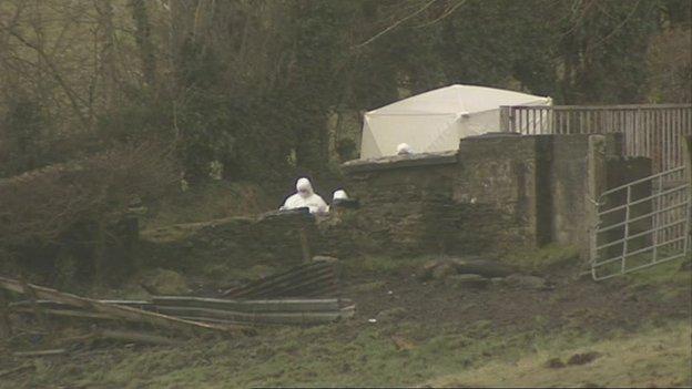 Police investigate the scene of the murder in 2010