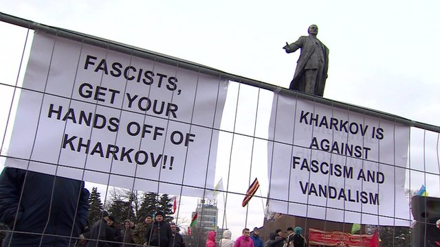 Anti-fascist signs and statue of Lenin
