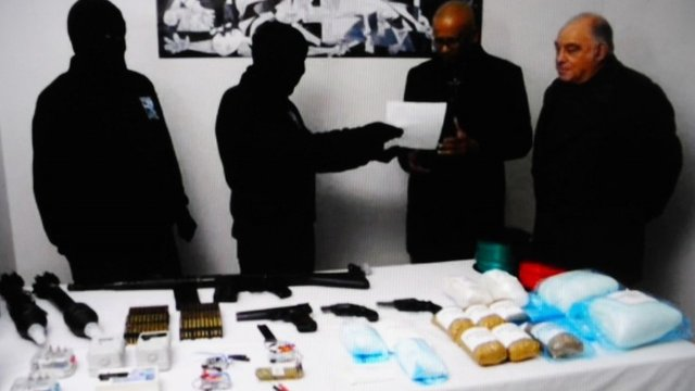 This photo of a video sequence released on February 21, 2014 by Naiz Info shows members of the International Verification Commission (IVC), Ram Mainikkalingam (2R) and Ronnie Kasrils (R)