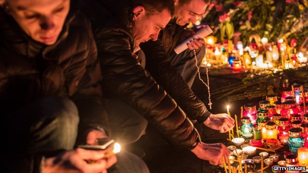 People light candles at a memorial for anti-government protesters killed in clashes with police in Independence Square on February 23, 2014 in Kiev, Ukraine.