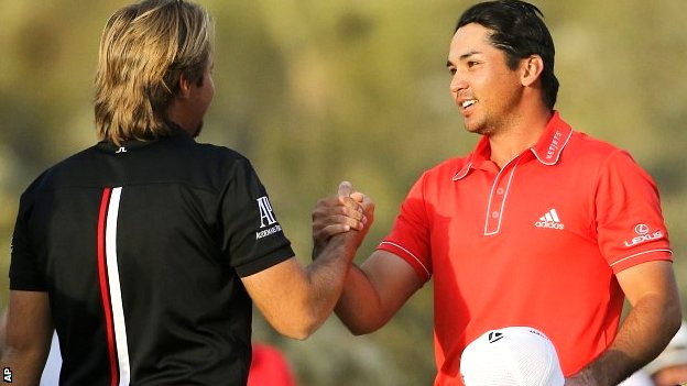 Jason Day (right) is congratulated by Victor Dubuisson after winning the WGC Match Play title in Arizona