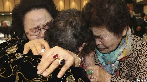 North Korean Kim Tae Un (C), 78, and her South Korean sisters Kim Sa-bun (L) and Kim Young-sun cry as they hug each other during their family reunion at the Mount Kumgang resort in North Korea, 23 February 2014