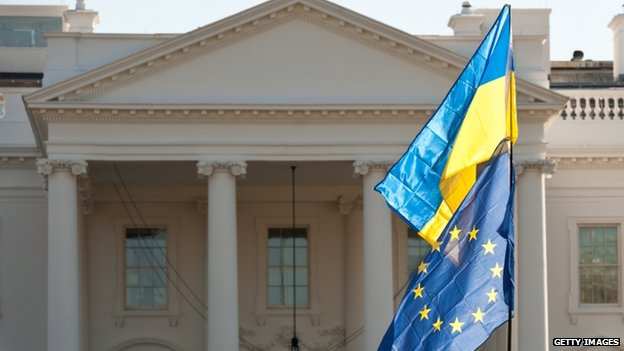 Ukrainian and European Union flags fly in front of the White House during a protest against ousted Ukrainian president Viktor Yanukovych in Washington on February 23, 2014.