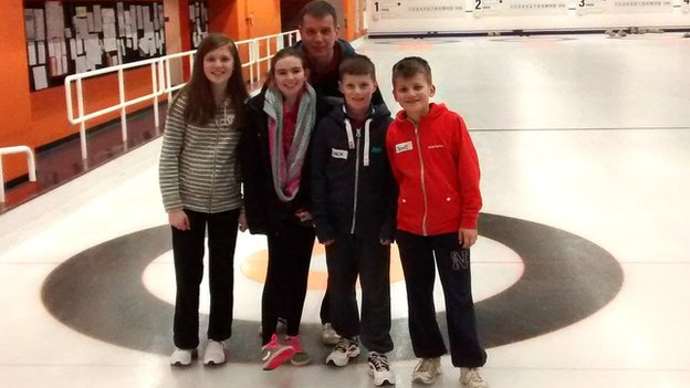 Kids and father after curling lesson
