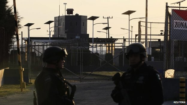 Federal police officers stand guard outside the Altiplano prison in Almoloya de Juarez on 22 February 2014