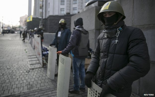 Activists guard a government building Kiev