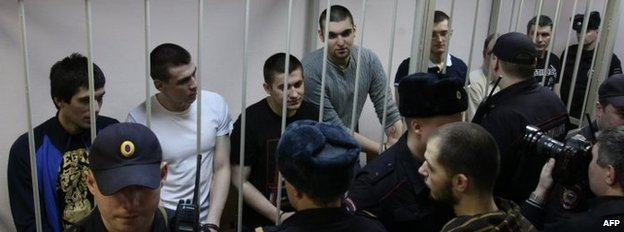 Anti-Putin protesters accused of instigating mass riots at Bolotnaya square stand inside the defendant cage in Zamoskvoretsky district court in Moscow during their trial on Monday