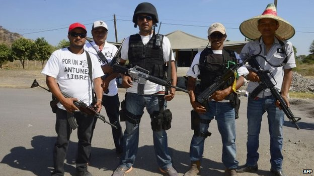 "Members of a ""self-defence group"" pose for a picture in Antunez, Michoacan state, on 15 February, 2014"